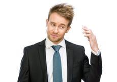Hombre de negocios que guarda el teléfono celular Imagen de archivo