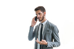 Hombre de negocios que habla en el teléfono Fotos de archivo libres de regalías