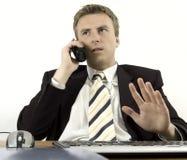 Hombre de negocios que habla en el teléfono foto de archivo libre de regalías