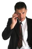 Hombre de negocios que habla en el teléfono que negocia algunos tratos serios Fotos de archivo