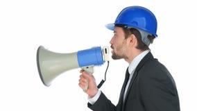 Hombre de negocios que habla en un megáfono metrajes