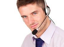 Hombre de negocios que habla en un receptor de cabeza foto de archivo