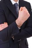 Hombre de negocios que hace gesto de mano ofensivo. imagenes de archivo