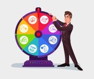 Hombre de negocios que hace girar la rueda de la fortuna Fotografía de archivo
