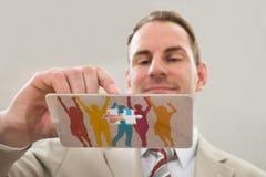 Hombre de negocios que hace la figura humana Fotos de archivo libres de regalías