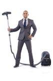 Hombre de negocios que hace la limpieza del vacío Imagen de archivo