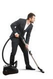 Hombre de negocios que hace la limpieza del vacío Foto de archivo libre de regalías