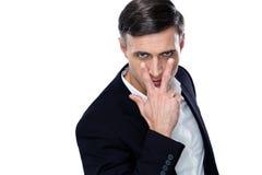 Hombre de negocios que hace la observación de usted gesticular Foto de archivo libre de regalías