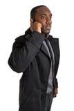Hombre de negocios que hace una llamada de teléfono Foto de archivo libre de regalías