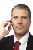Hombre de negocios que invita al teléfono móvil Foto de archivo