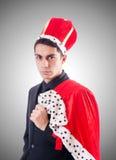 Hombre de negocios que juega al rey contra la pendiente Imágenes de archivo libres de regalías