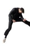 Hombre de negocios que juega saltar de Air Guitar del bastidor imágenes de archivo libres de regalías
