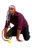 Hombre de negocios que juega a tenis Fotografía de archivo libre de regalías