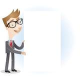 Hombre de negocios que lleva a cabo al tablero de mensajes en blanco Fotografía de archivo libre de regalías