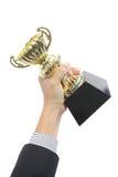 Hombre de negocios que lleva a cabo el premio del trofeo imagen de archivo libre de regalías