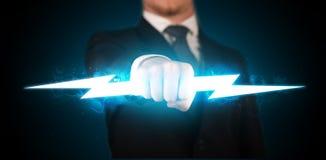 Hombre de negocios que lleva a cabo el rayo que brilla intensamente en sus manos Imagen de archivo libre de regalías