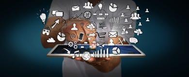 Hombre de negocios que lleva a cabo iconos dibujados mano del web Imagen de archivo libre de regalías