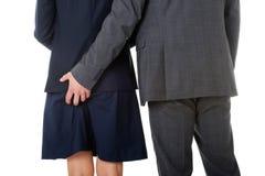 Hombre de negocios que lleva a cabo la mano en asno de los socios Foto de archivo