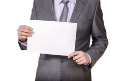 Hombre de negocios que lleva a cabo la muestra en blanco Fotos de archivo libres de regalías