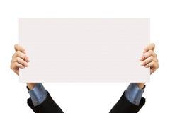 Hombre de negocios que lleva a cabo la muestra y la mano en blanco Imagenes de archivo