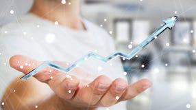 Hombre de negocios que lleva a cabo la representación azul digital de la flecha 3D Imagenes de archivo