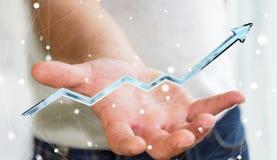 Hombre de negocios que lleva a cabo la representación azul digital de la flecha 3D Foto de archivo