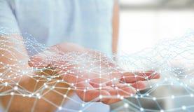Hombre de negocios que lleva a cabo la representación del punto 3D de la red del vuelo Imágenes de archivo libres de regalías