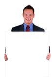 Hombre de negocios que lleva a cabo una muestra Imágenes de archivo libres de regalías