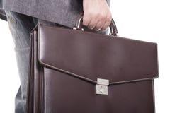 Hombre de negocios que lleva una cartera Foto de archivo
