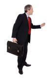 Hombre de negocios que lleva una cartera Imágenes de archivo libres de regalías