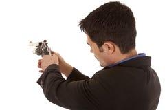 Hombre de negocios que mira abajo del arma Fotos de archivo
