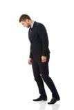 Hombre de negocios que mira abajo en el piso Imagen de archivo