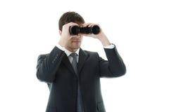 Hombre de negocios que mira con los prismáticos Foto de archivo