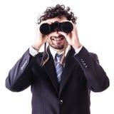 Hombre de negocios que mira a través de los prismáticos Fotografía de archivo libre de regalías