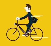 Hombre de negocios que monta una bici del vintage Foto de archivo