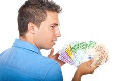 Hombre de negocios que muestra el dinero Fotos de archivo
