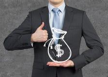Hombre de negocios que muestra el pulgar para arriba Imágenes de archivo libres de regalías
