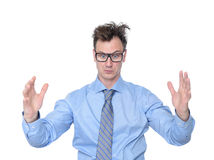 Hombre de negocios que muestra el tamaño grande de sus manos Imagen de archivo