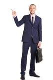 Hombre de negocios que muestra la dirección Foto de archivo