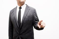 Hombre de negocios que muestra la mano y el finger Fotografía de archivo