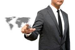Hombre de negocios que muestra la mano y el finger con la imagen del mundo Foto de archivo libre de regalías