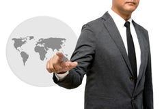 Hombre de negocios que muestra la mano y el finger con la imagen del mundo Imagen de archivo libre de regalías