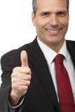 Hombre de negocios que muestra la muestra del thumbs-up Imagen de archivo