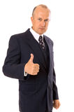 Hombre de negocios que muestra los pulgares para arriba Fotos de archivo libres de regalías