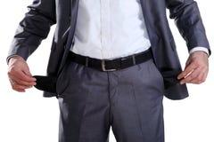 Hombre de negocios que muestra sus bolsillos vacíos 2 Foto de archivo libre de regalías