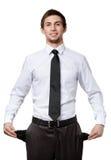 Hombre de negocios que muestra sus bolsillos vacíos Imagen de archivo