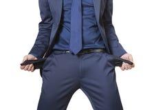Hombre de negocios que muestra sus bolsillos vacíos Foto de archivo