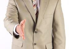 Hombre de negocios que ofrece sacudir las manos Imagen de archivo libre de regalías