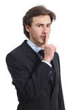 Hombre de negocios que pide silencio shh foto de archivo libre de regalías
