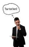 Hombre de negocios que piensa y que sostiene una tableta Fotos de archivo